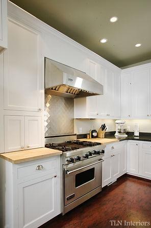 white kitchen small stainless steel range
