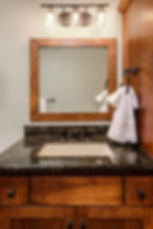 bathroom sink wood mirror granite