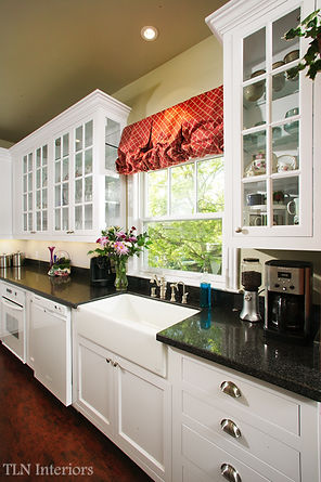 white kitchen glass cabinets black counter