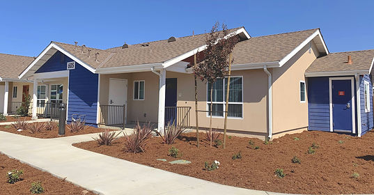 Santa Barbara County rental propery house tan and blue with new landscaping