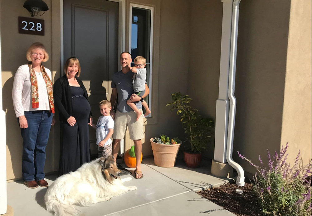 Jennifer McGovern and a family in Santa Barbara county with dog at house front door