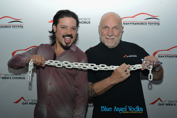 """Celso Dulay and Dr. Tim Seelig greet guests at """"Unbreakable"""" fundraiser"""