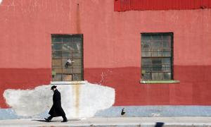 Man walking along Brooklyn street