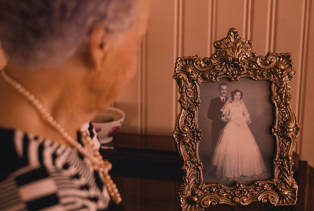 Woman reflecting on memory and family photo
