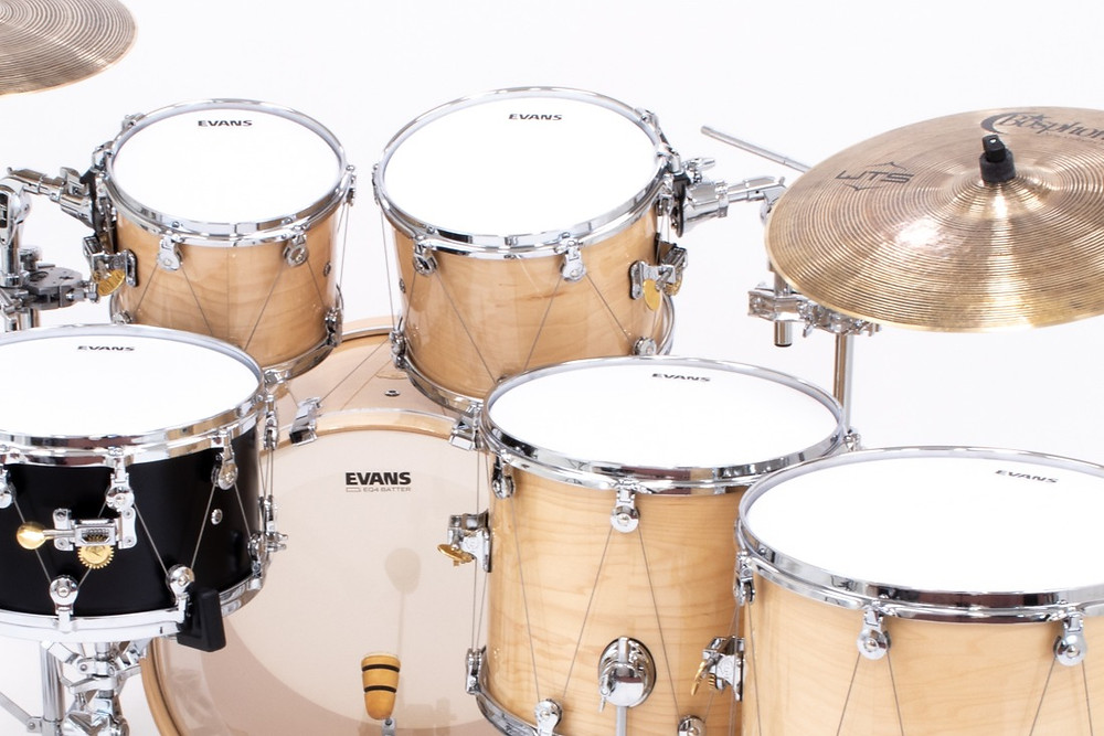 Synthetic drum heads