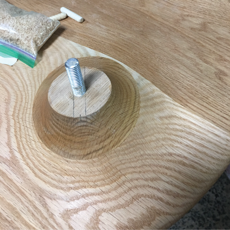 6. Place threaded insert in base.