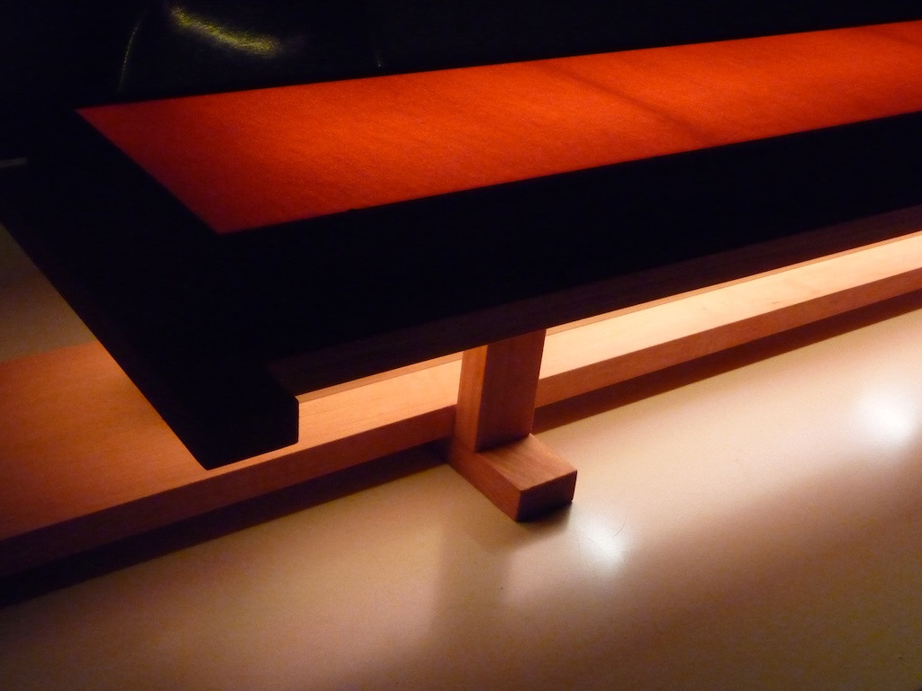 Japanese inspired light piece with two 2' flourescent bulbs wrapped in red silk.