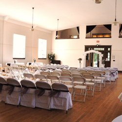 Ballroom with White Chairs