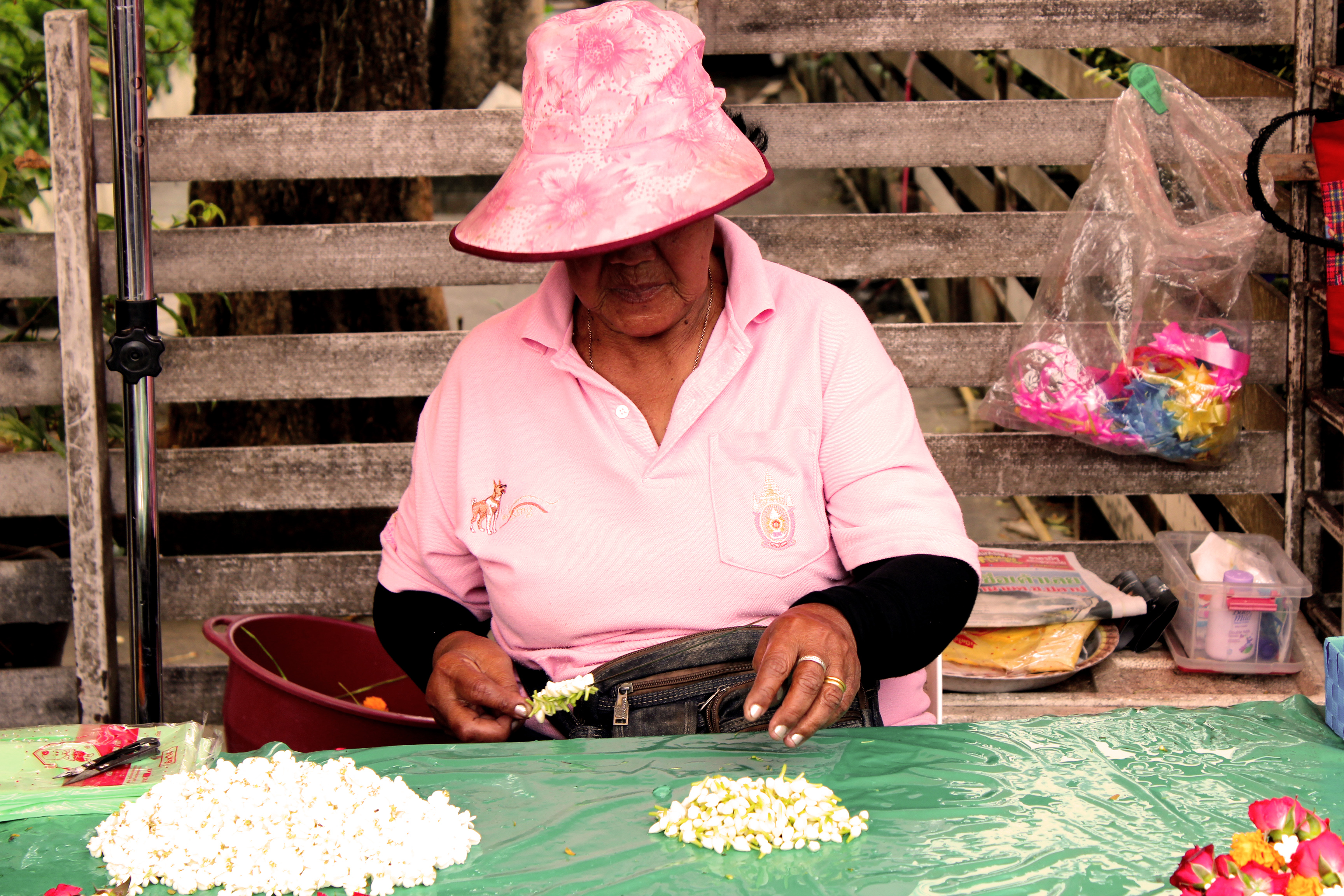 Lady making flower neckless