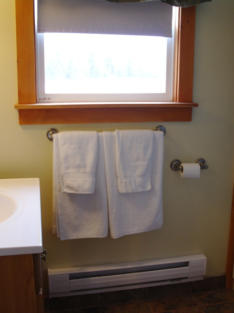 There is 1 main bathroom in each cottage with a tub/shower combination.