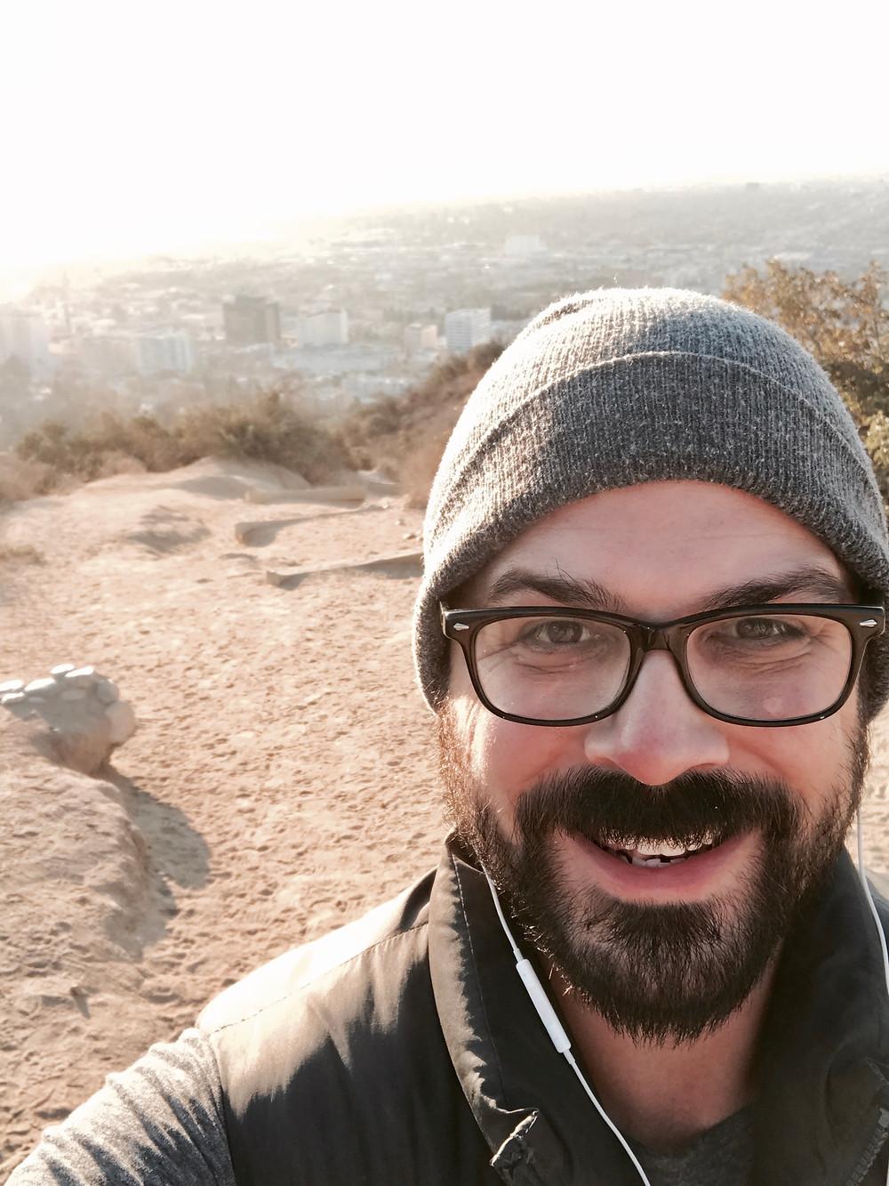Jesse Brune-Horan smiling on mountain top