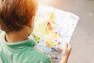 Child reading a map, looking for where to go next as a mataphor for thinking about a career change