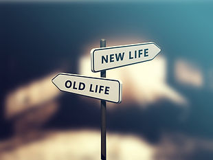 "signpost showing ""old life"" and ""new life"" directions"