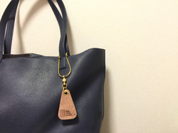 three fifteen fragrance leather tag