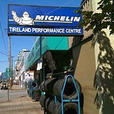 michelin sign, tireland performance centre, tire racks