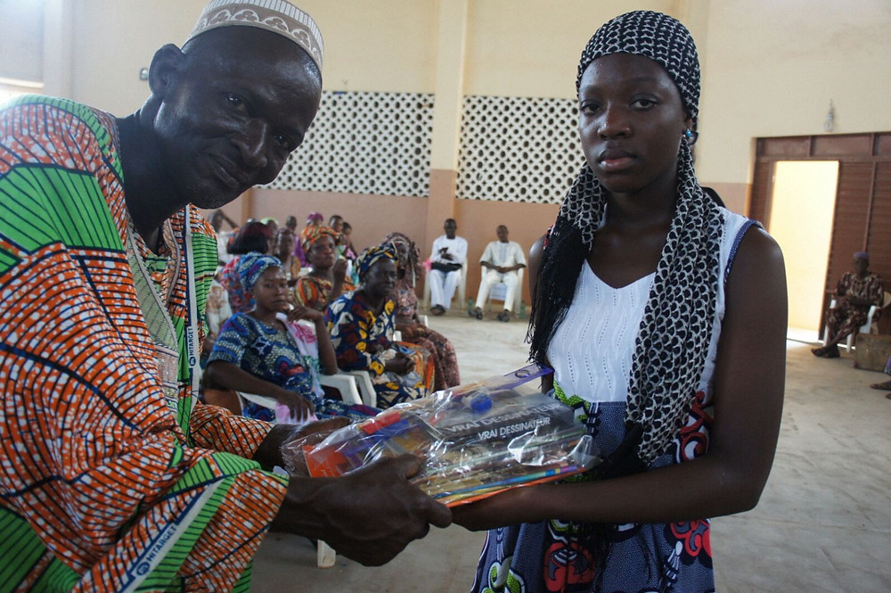 Marie Olga Agani receiving her scholarship package from one of the parents present that day
