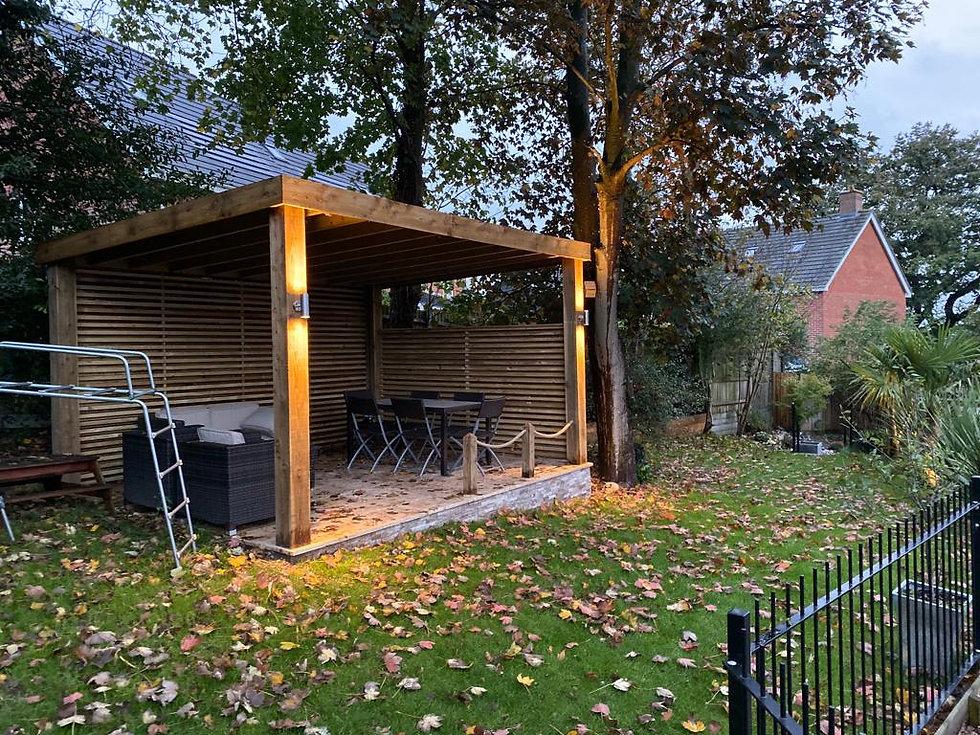Outdoor seating area lights on beams.jpg