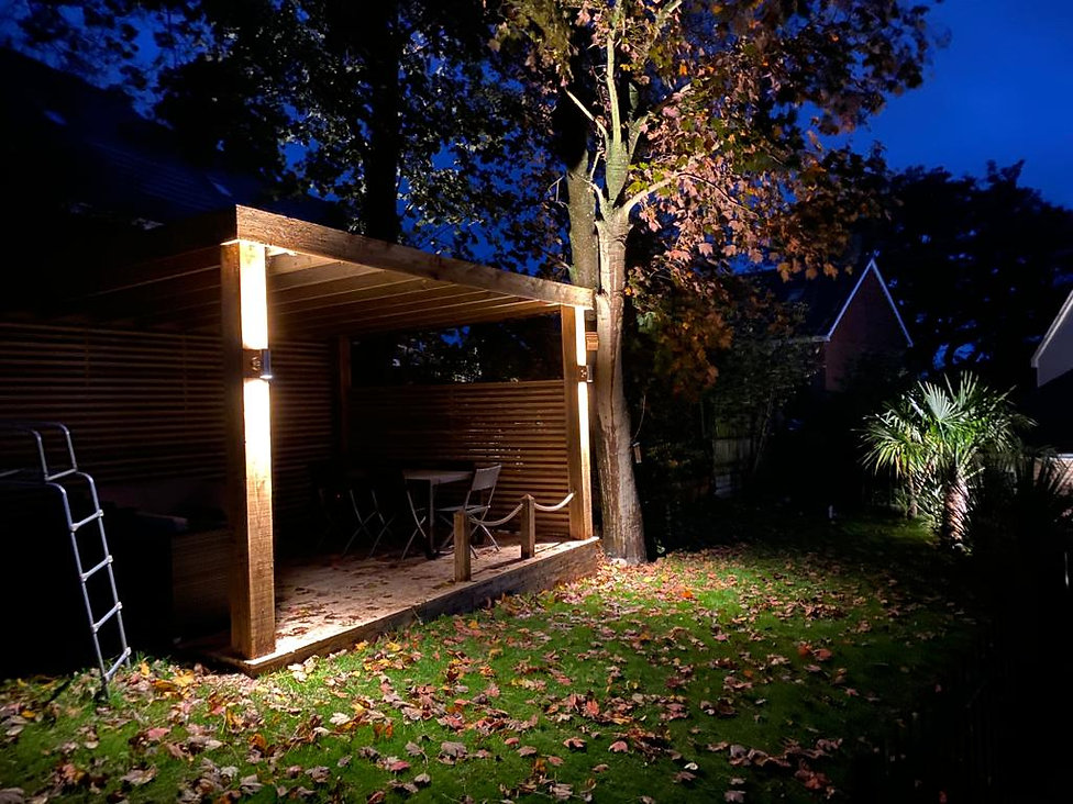 Outdoor seating area lights on beam dark