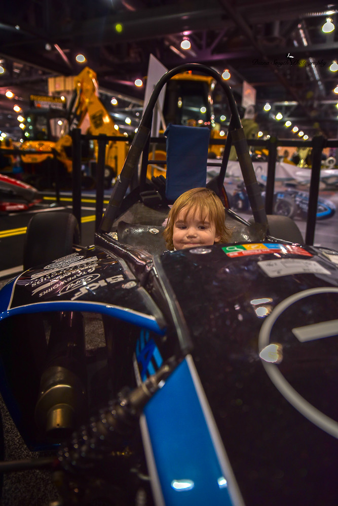 This little guy loved the blue race car. As tiny as he was sitting in it, it was a thrill bigger than he was.