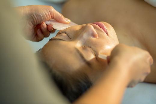 Young woman receiving facial rejuvenatio