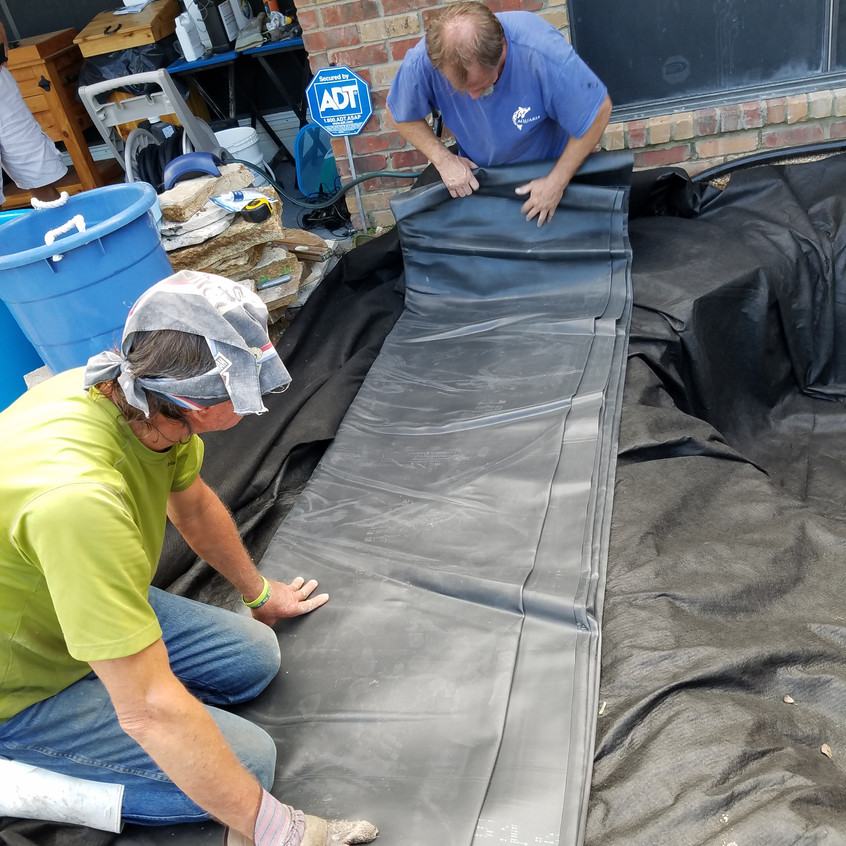 15-Rolling the EPDM Liner Out