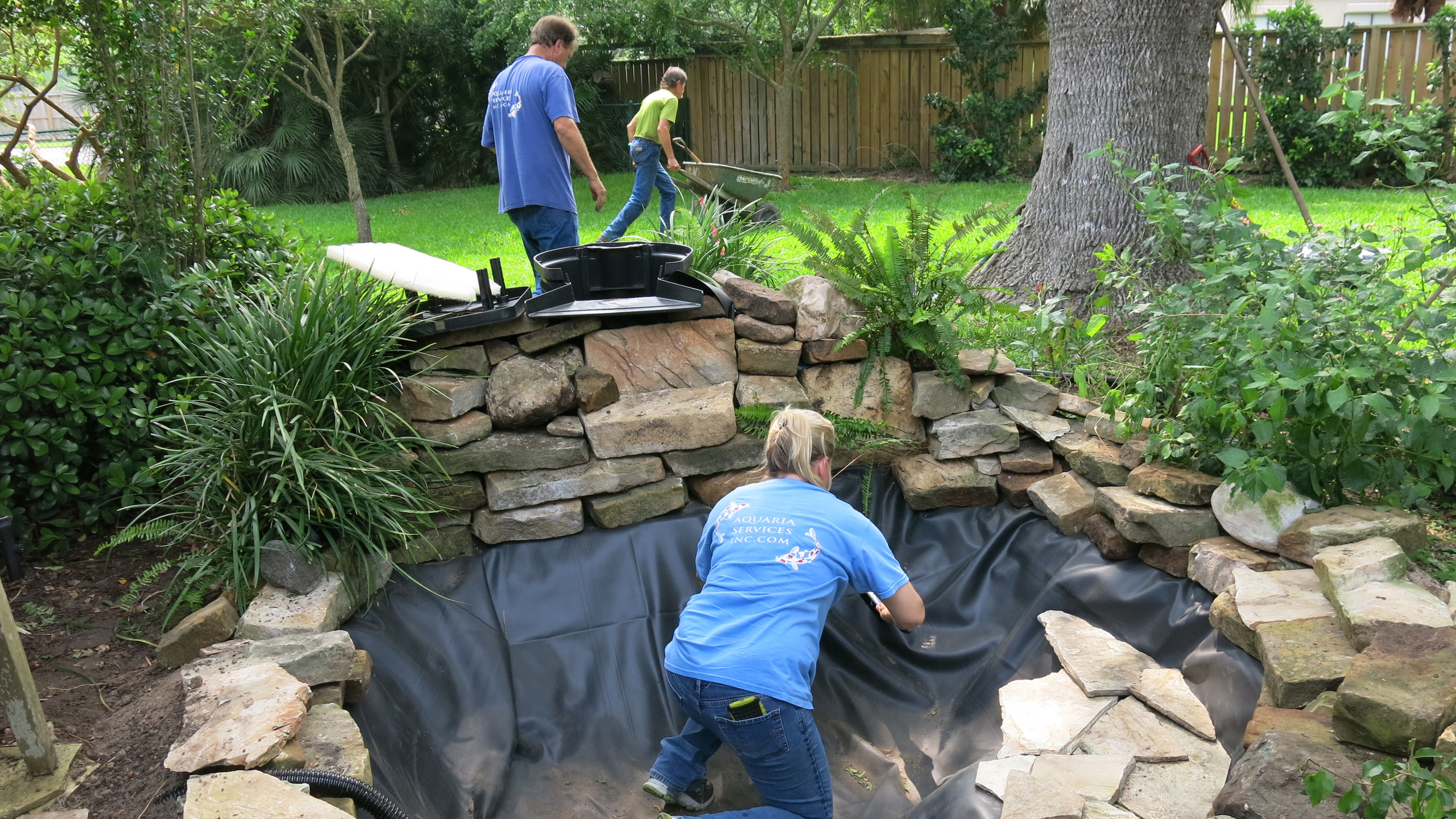 25-Cleaning Construction Debris from Interior of Pond