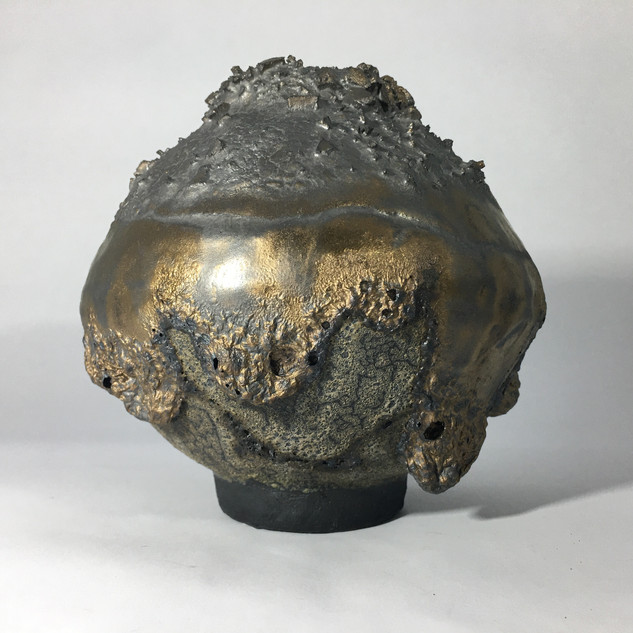 stoneware vessel using a selection of hand mixed and commercial glazes