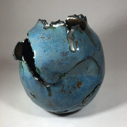 Tim Kennedy Ceramics. Chocolate black earthenware 'fractured' vessel with blue glaze and copper oxide.