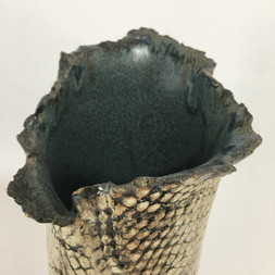 detail of earthernware textured vase