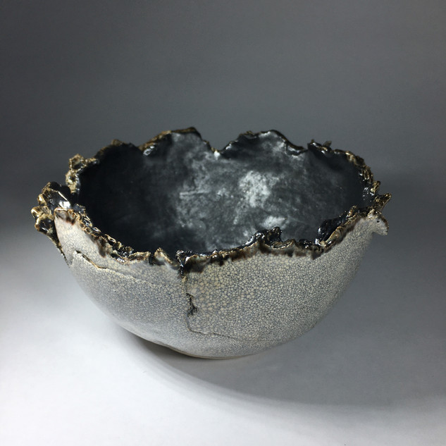earthernware bowl with torn rim and crackle glaze