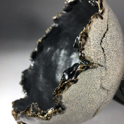 eartherware bowl with torn rim and crakle glaze