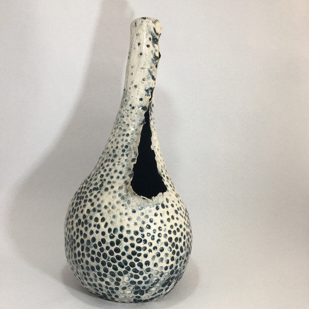 coiled textured earthernware vessel