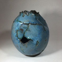 chocolate black earthernware vessel with blue glaze and copper oxide