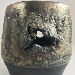thrown and altered stoneware vessel with volcanic and metallic glazes.  made in collaboration with Steven Edwards Ceramics
