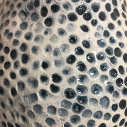 detail of earthernware textured vessel