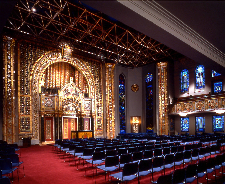 Historic synagoge interior, lightig for the Arc and polychrome decoration, stack seating, space frame