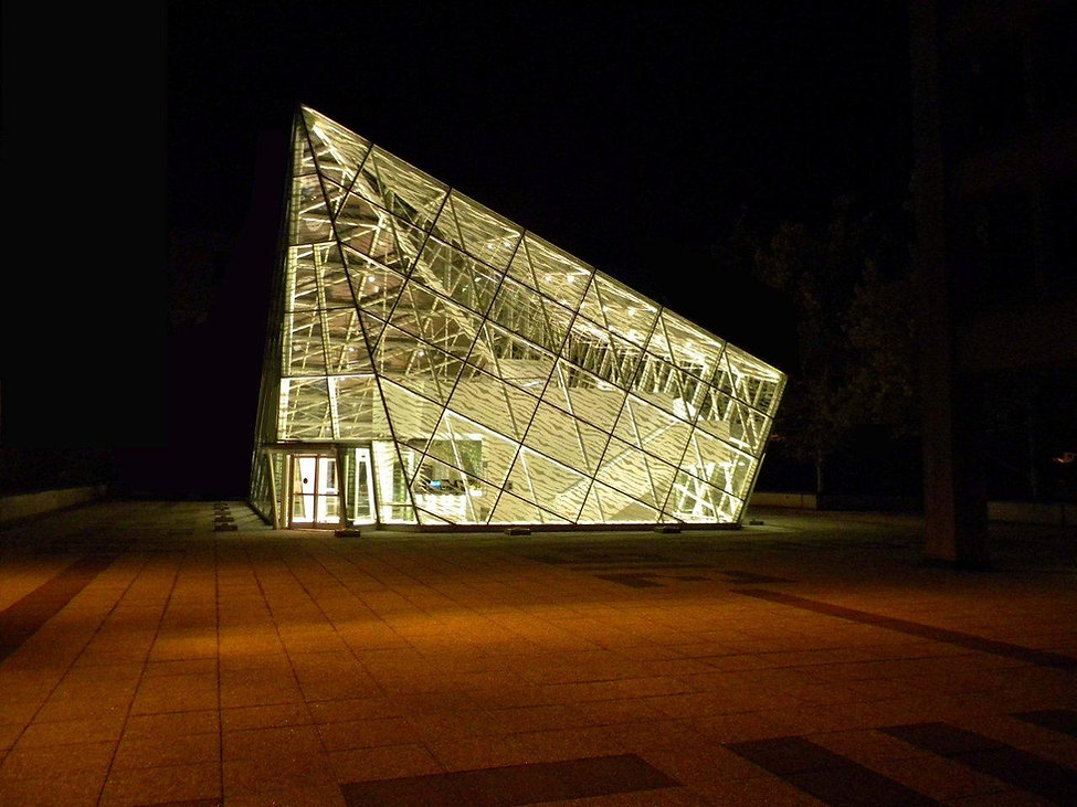Polyform glass structure, night lighting, studet center addition