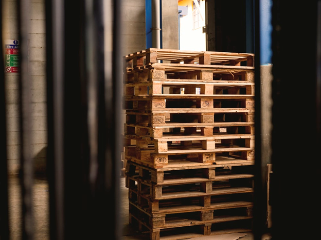 Stacked heat treated wooden pallets in a warehouse