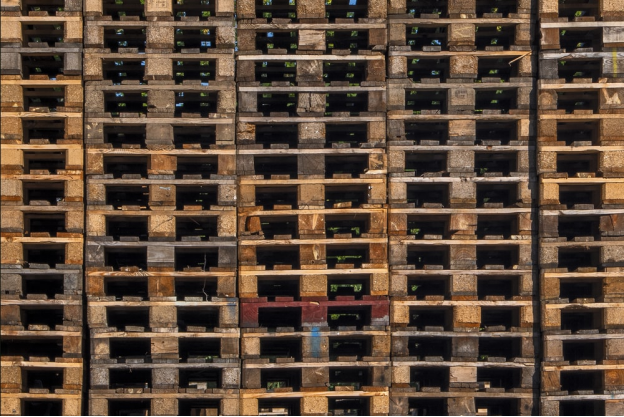 Wooden pallets stacked outside a brewery