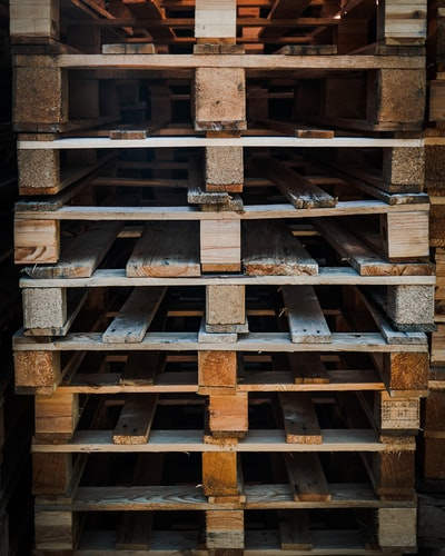 Stacked wood pallets.