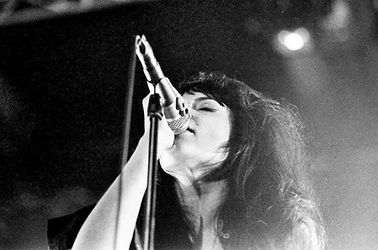 Lady singing live on stage
