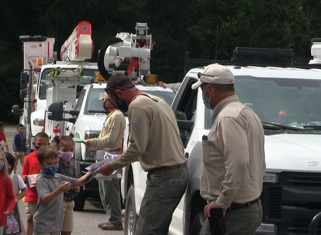 First graders at Northeast Elementary thank Mississippi Power workers
