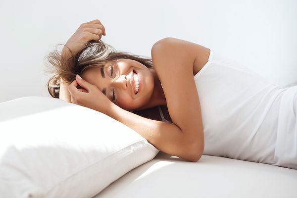 young woman sleeping happily.jpg