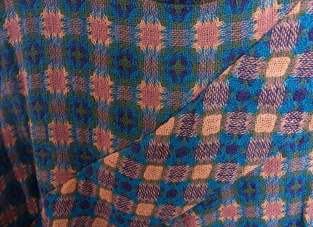 Close up of garment using both sides of a false double weave.