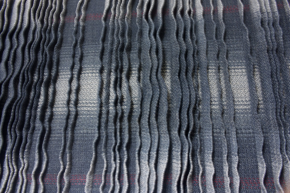 Double weave with pleats, gray to dark gray gradients.