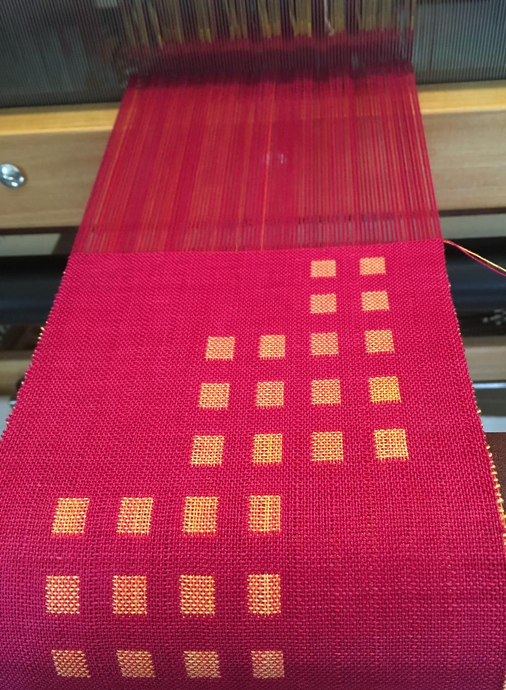 Weaving on the loom.