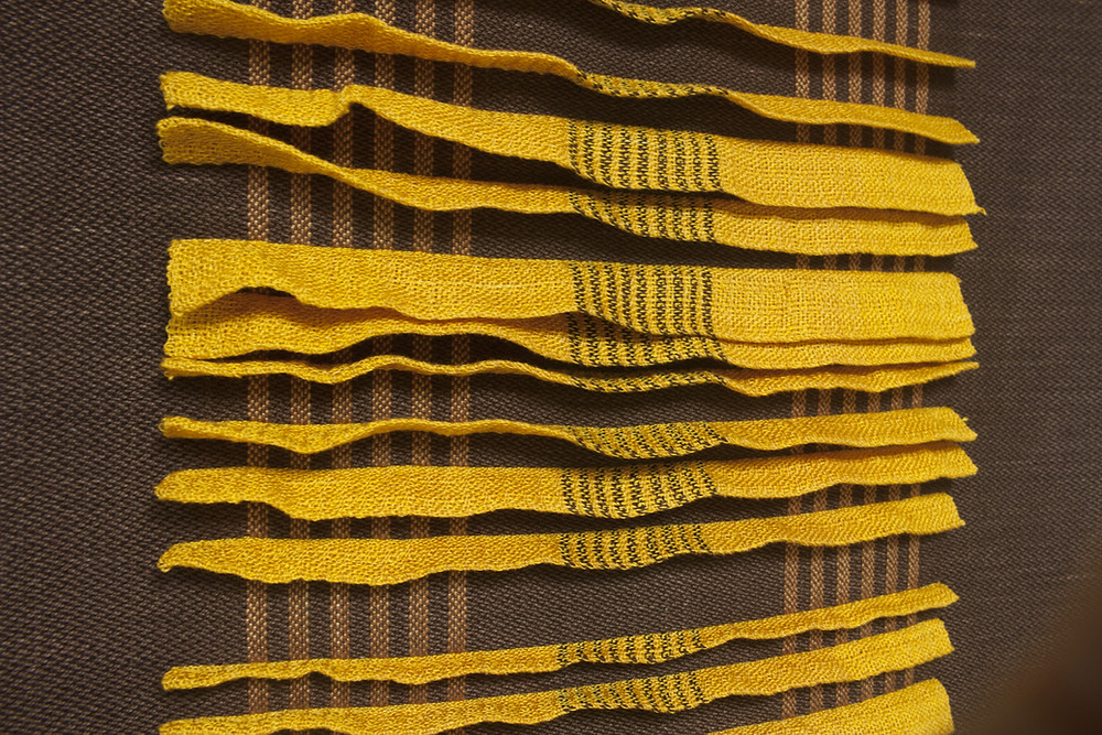 detail of weaving with stripes and double weave pleats