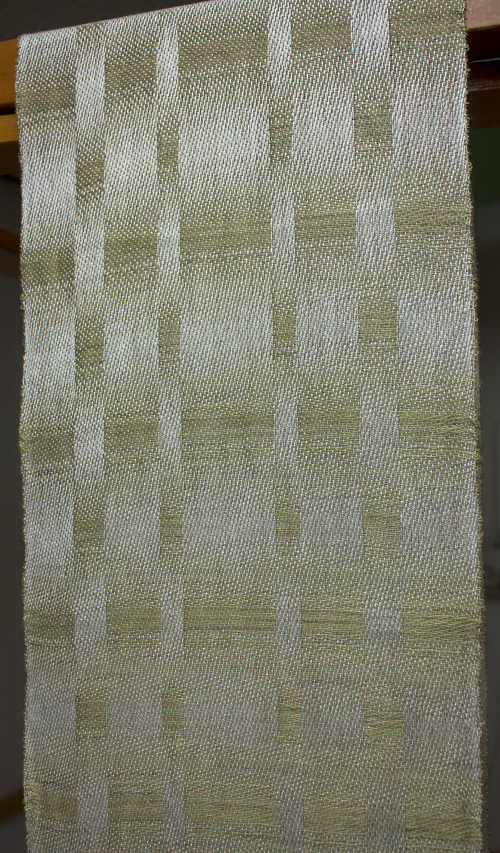 close up of green and white scarf