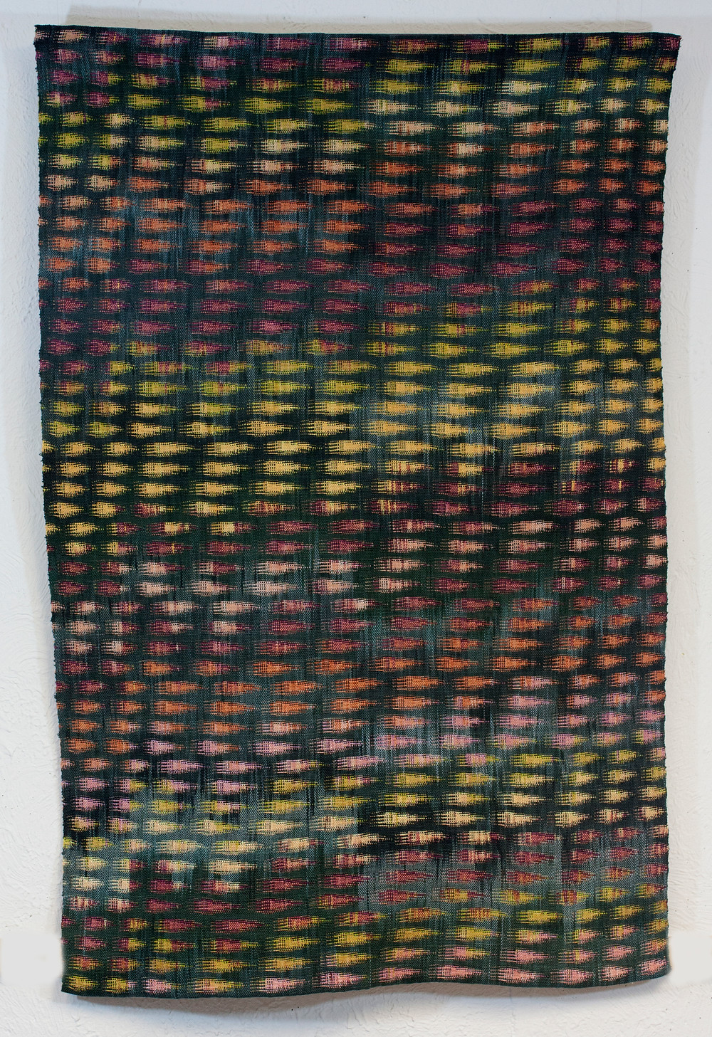 Double weave with a repeated motif that is stagger.  Stagger also repeats.