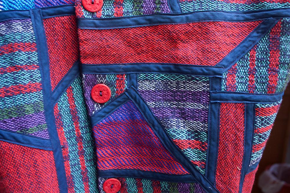 Detail of multi-color, patchwork garment